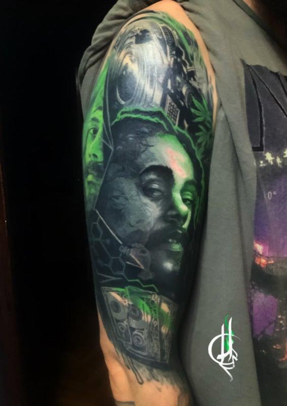 Tatuaje estilo surrealismo de Bob Marley